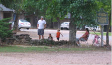 July 2012: Rev. David Harrell stops for a visit at the wading pool