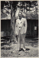 Rev. Clarence Calcote stands before the Calcote tent in 1950s