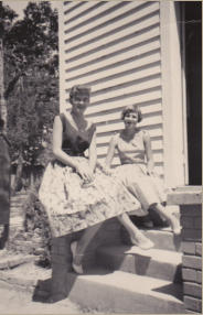 1950s: photo taken on steps at front door of church. Rosemary Love (l) and Charlotte Gaston (r)