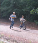 2013: Ben Carr teaching Mike McCarley to ride bicycle